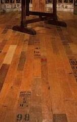 Flooring made from the tops of wine barrels.