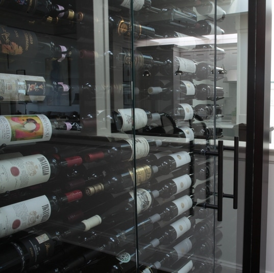 West vancouver custom glass wine cabinet glass doors with oil rubbed bronze ladder pull handles on custom wine cabinet eventshaper