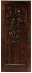 wine cellar door in solid wood with grapevine carving