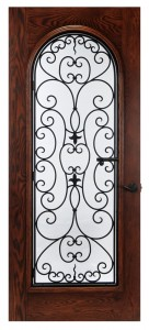 wine cellar door with wrought iron detailing